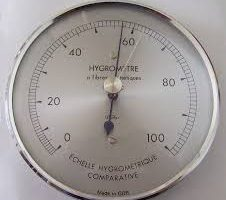 A hygrometer showing humidity approaching 60 percent.