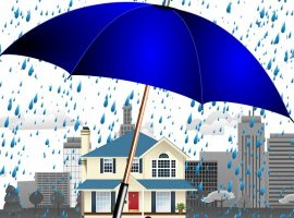 umbrella sheltering a house in rain storm